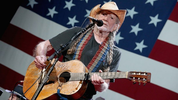 Willie Nelson, pictured here performing on July 4 in Austin, Texas, announced Wednesday he's canceling his tour due to health problems.