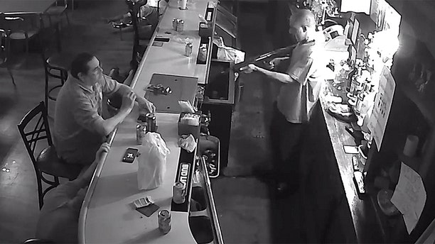 Tony Tovar lit a cigarette as Behrmann's Tavern was robbed Wednesday by a man with a weapon.
