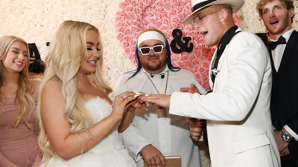 L-R: Tana Mongeau, Arman Izadi, Jake Paul and Logan Paul as Jake Paul and Tana Mongeau get married at Graffiti House on July 28, 2019 in Las Vegas, Nevada.