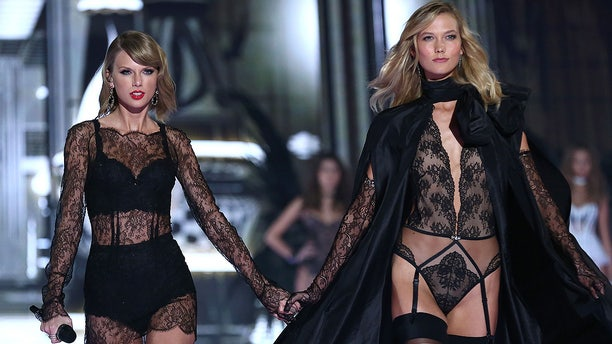 Taylor Swift and Karlie Kloss walking the runway at the Victoria's Secret fashion show in London, in December 2014. The pair used to be so close that Kloss even had her own room in Swift's New York City apartment.
