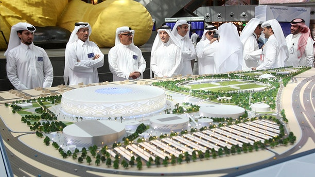 Akbar al-Baker, Qatar Airways Chief Executive, looks at a model of Al Thumama stadium during an unveiling ceremony at Hamad International Airport in Doha, Qatar, August 24, 2017.