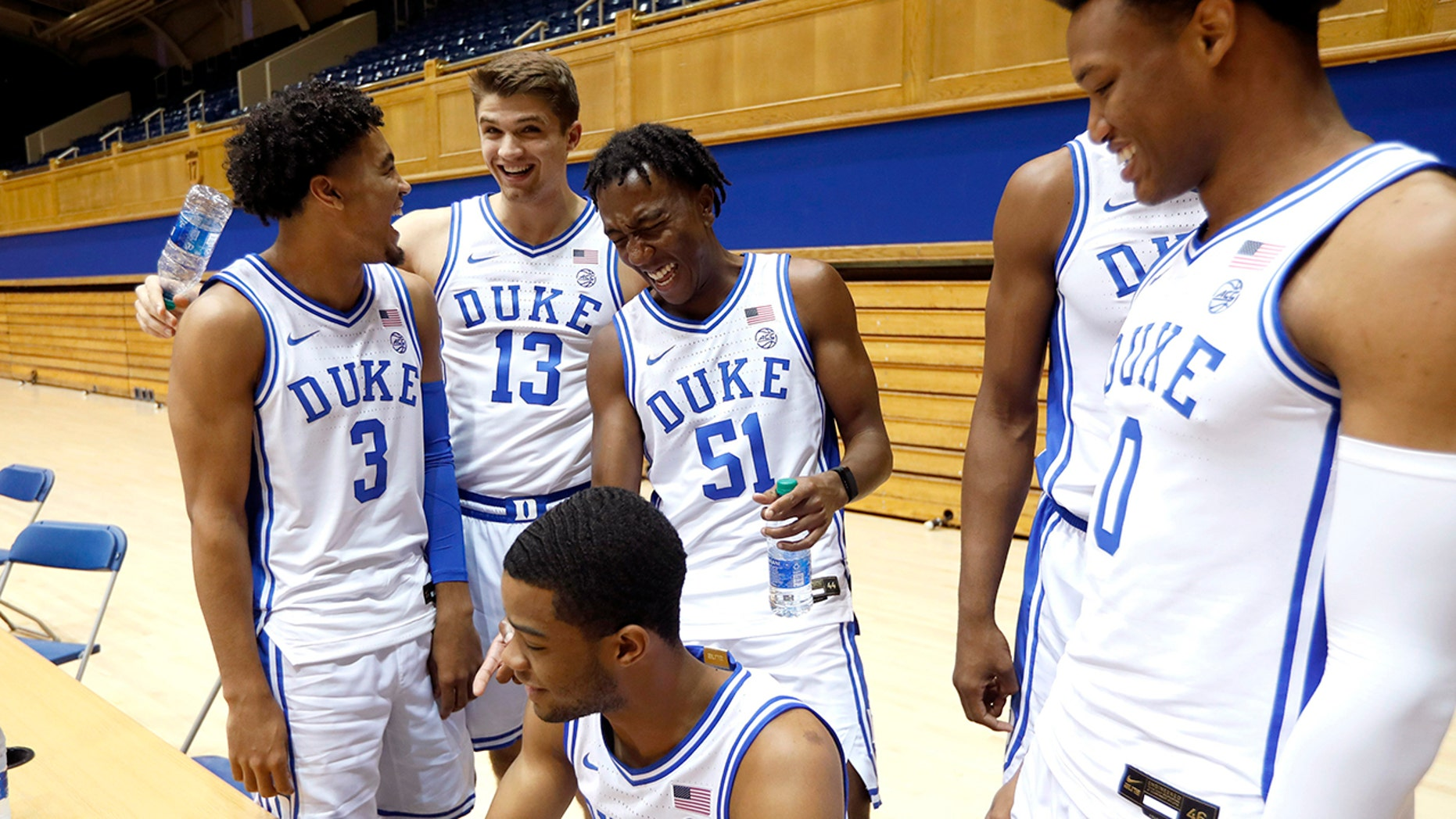 Duke's Tre Jones (3) laughs with Joey Baker (13), Mike Buckmire (51), Cassius Stanley (2), bottom left, and Wendell Moore (0) during an NCAA college basketball media day at Cameron Indoor Stadium in Durham, N.C., Monday, Sept. 23, 2019. (Ethan Hyman/The News & Observer via AP)
