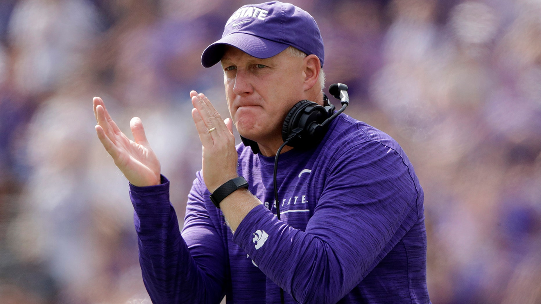 Kansas State head coach Chris Klieman cheers on his players during the first half of an NCAA college football game against Bowling Green Saturday, Sept. 7, 2019, in Manhattan, Kan. (AP Photo/Charlie Riedel)