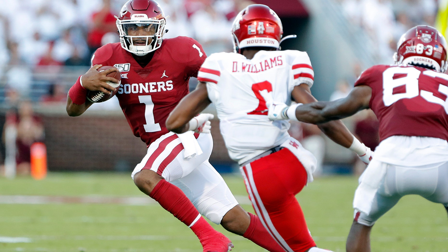 Oklahoma quarterback Jalen Hurts (1) runs the ball against Houston during the first half of an NCAA college football game in Norman, Okla., Sunday, Sept. 1, 2019. (AP Photo/Alonzo Adams)