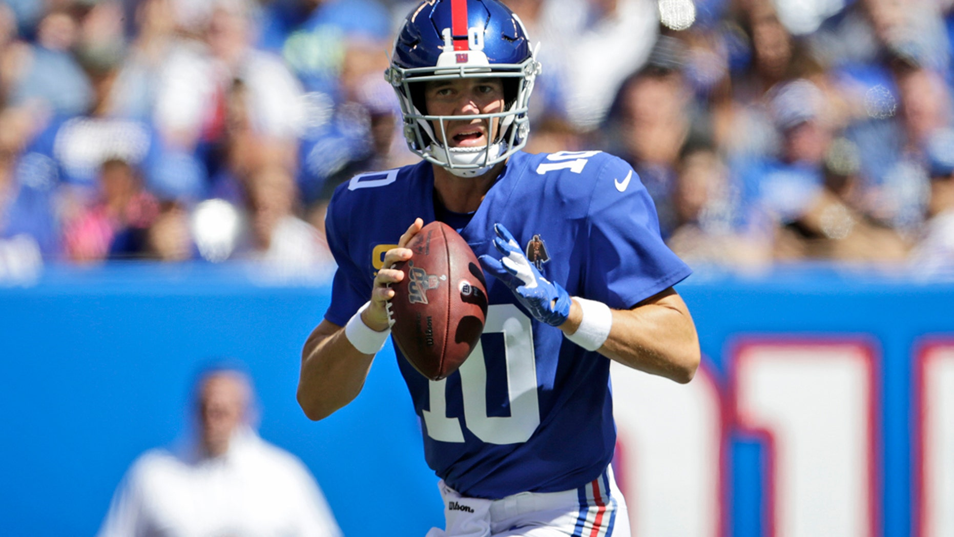 """New York Giants quarterback Eli Manning looks to throw during the first half of an NFL football game against the Buffalo Bills, Sunday, Sept. 1<div class=""""e3lan e3lan-in-post1""""><script async src=""""//pagead2.googlesyndication.com/pagead/js/adsbygoogle.js""""></script> <!-- Text_Display_Ad --> <ins class=""""adsbygoogle""""      style=""""display:block""""      data-ad-client=""""ca-pub-7542518979287585""""      data-ad-slot=""""2196042218""""      data-ad-format=""""auto""""></ins> <script> (adsbygoogle = window.adsbygoogle 