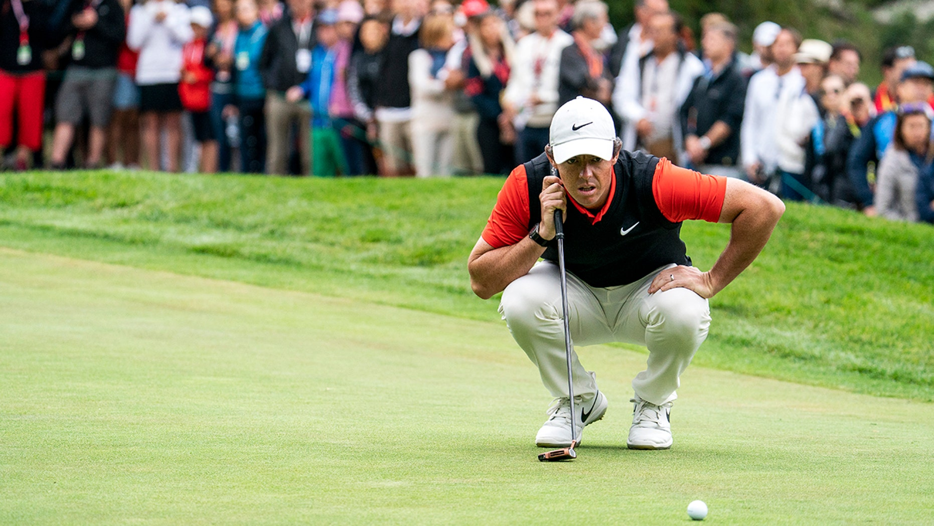 Rory McIlroy of Northern Ireland lines up a putt during the final round the final round of the European Masters golf tournament in Crans-Montana, Switzerland, Sunday, September 1, 2019. (Alexandra Wey/Keystone via AP)