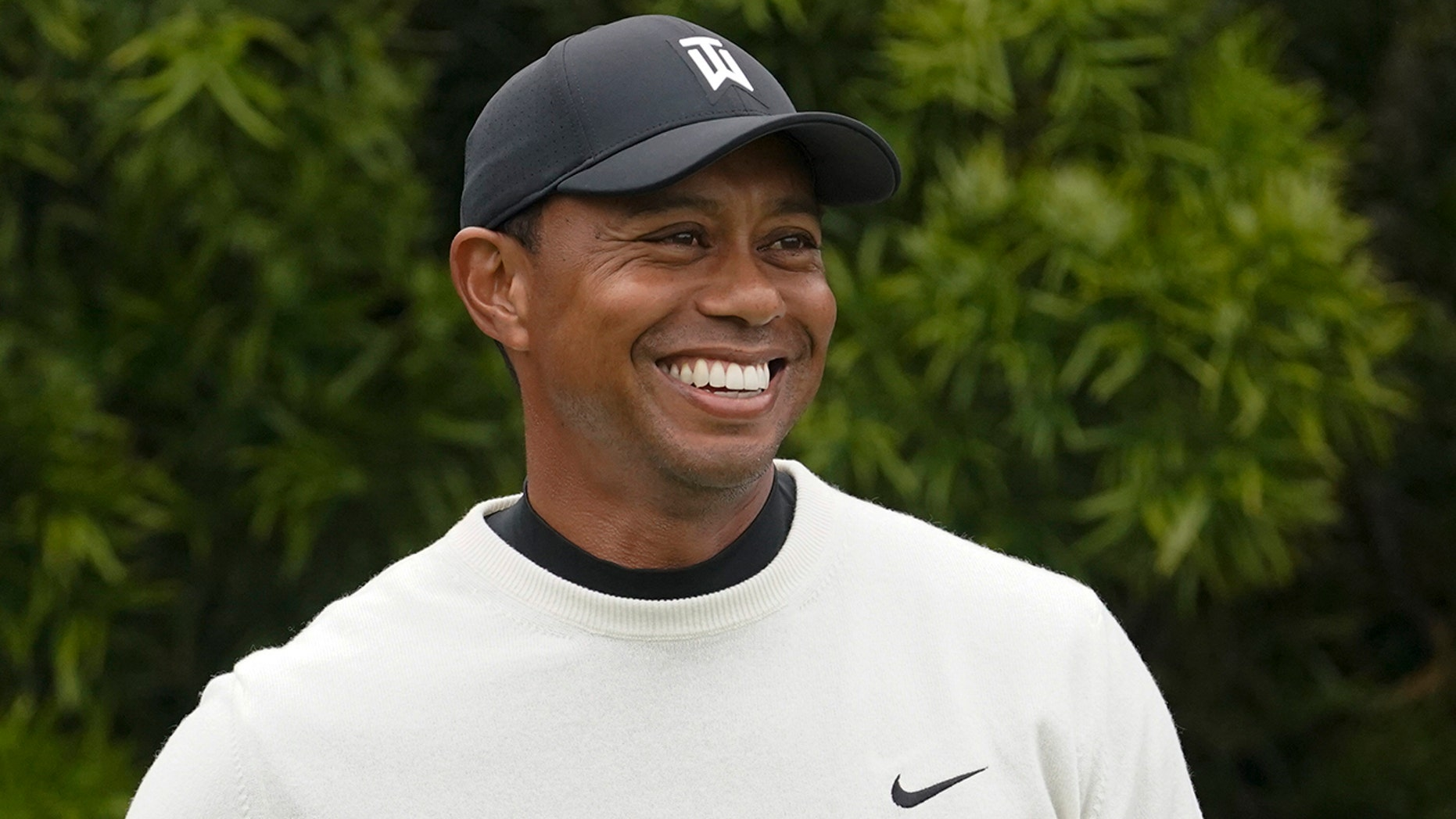 FILE - In this June 12, 2019, file photo, Tiger Woods smiles on the 12th hole during a practice round for the U.S. Open golf tournament in Pebble Beach, Calif. Woods will take part in a Japan Skins game on Oct. 21 that will be shown live worldwide by Discovery-owned GOLFTV. (AP Photo/David J. Phillip, File)