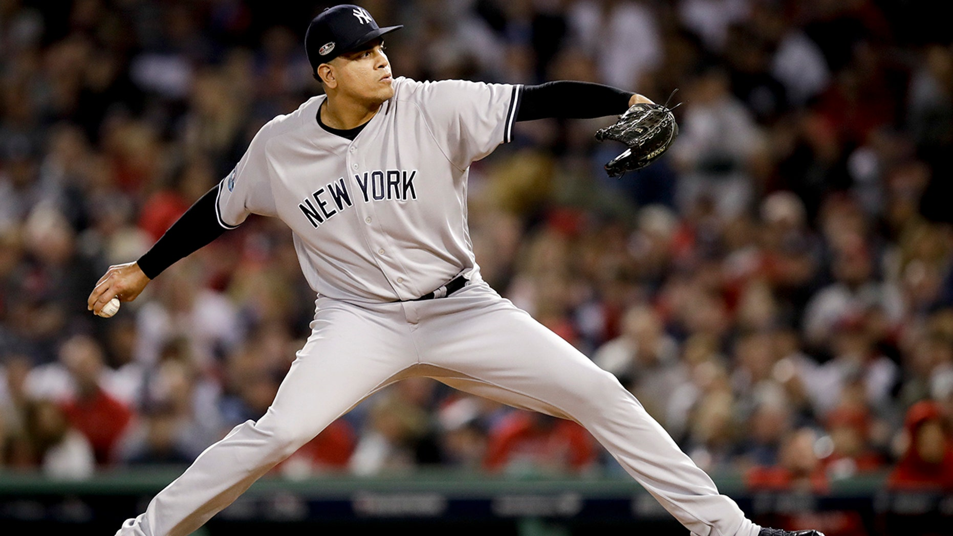 FILE - In this Oct. 6, 2018, file photo, New York Yankees relief pitcher Dellin Betances throws against the Boston Red Sox during the sixth inning of Game 2 of a baseball American League Division Series in Boston. Betances' season appears over after just eight pitches. The Yankees say the reliever partially tore the Achilles tendon in his left foot when he hopped on the mound after striking out Brandon Drury, the second and final batter he faced in his season debut at Toronto. (AP Photo/Charles Krupa, File)