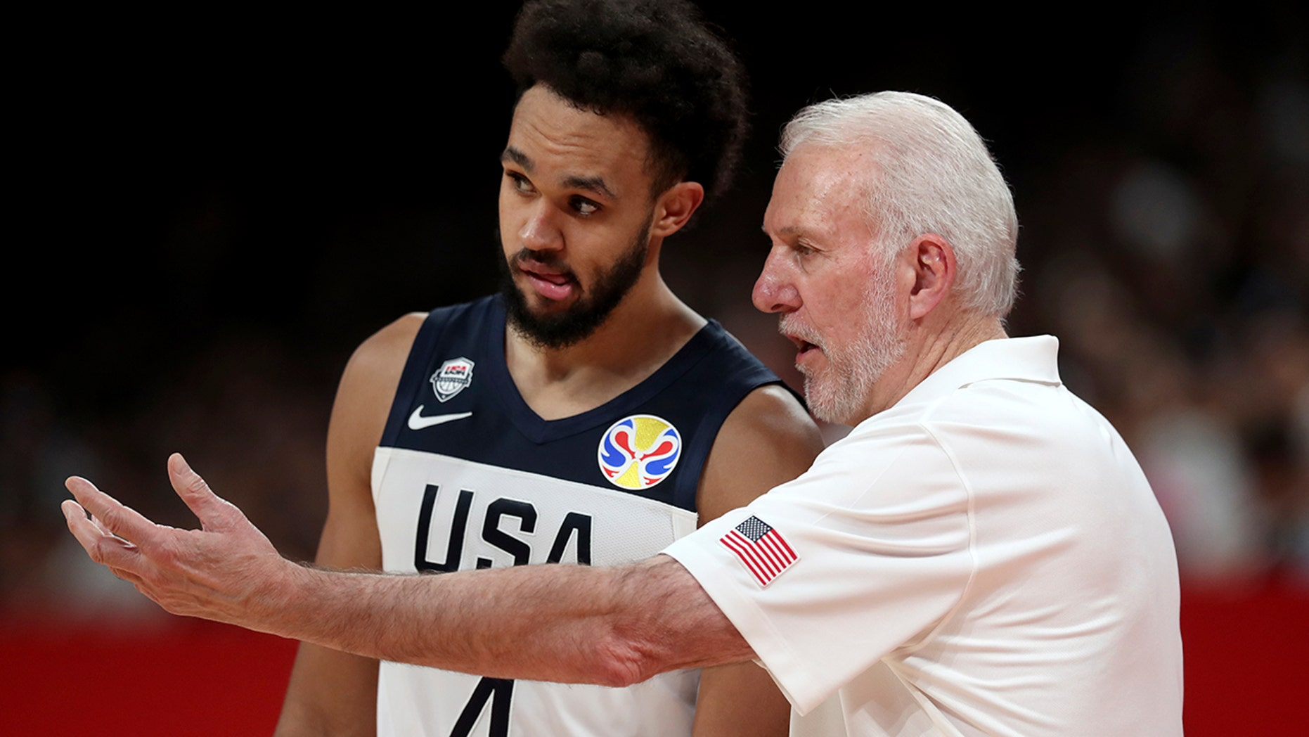 United States' coach Gregg Popovich, right instructs United States' Derrick White during a match against Brazil for the FIBA Basketball World Cup at the Shenzhen Bay Sports Center in Shenzhen on Monday, Sept. 9, 2019. (AP Photo/Ng Han Guan)