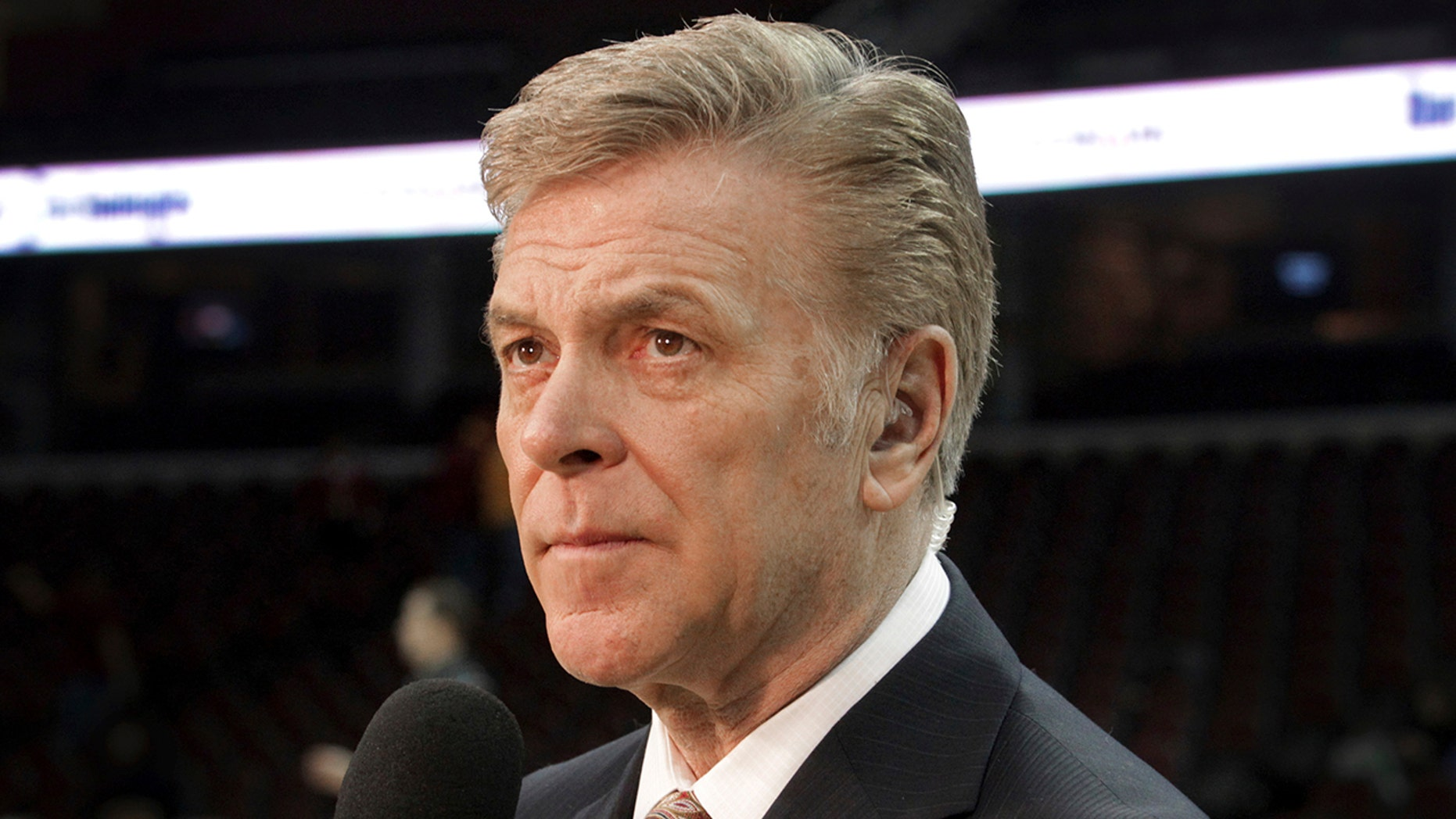 "In this Feb. 19, 2014, photo, longtime sportscaster and announcer Fred McLeod is shown at a Cleveland Cavaliers game in Cleveland. McLeod has died. He was 67. The Cavaliers said McLeod died suddenly Monday night, Sept. 9, 2019, but did not elaborate. They called him a ""great friend and teammate"" and a ""heart-felt ambassador."" (Lynn Ischay/The Plain Dealer via AP)"