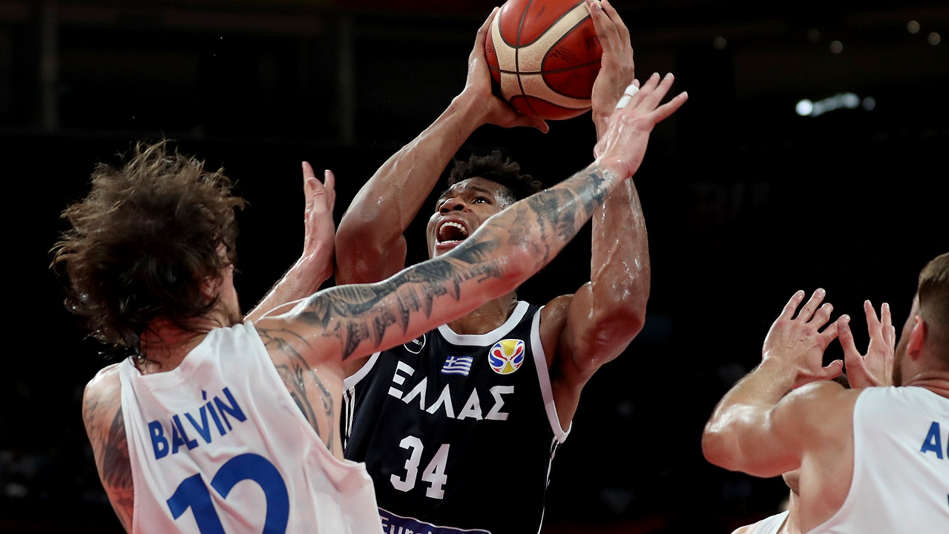 Greece's Giannis Antetokounmpo tries to shoot past Czech Republic's Ondrej Balvin during a phase two match for the FIBA Basketball World Cup at the Shenzhen Bay Sports Center in Shenzhen on Monday, Sept. 9, 2019. (AP Photo/Ng Han Guan)
