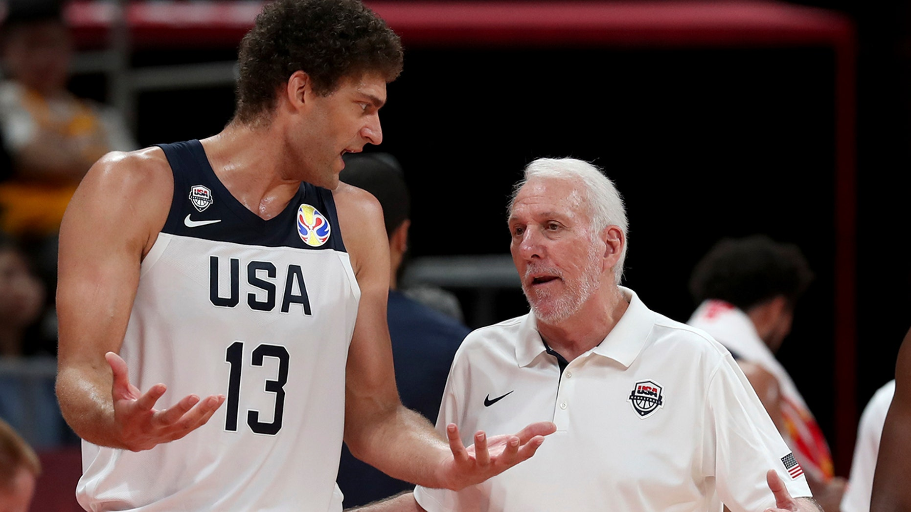 United States' coach Gregg Popovich chats with United States' Brook Lopez during a consolation playoff game against Poland for the FIBA Basketball World Cup at the Cadillac Arena in Beijing on Saturday, Sept. 14, 2019. U.S. defeated Poland 87-74 (AP Photo/Ng Han Guan)