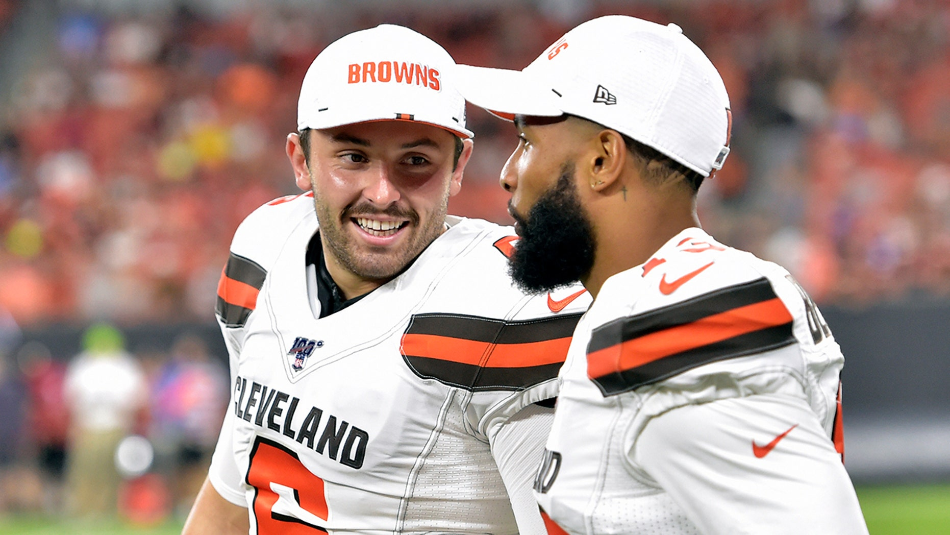 FILE - In this Aug. 8, 2019, file photo, Cleveland Browns' Baker Mayfield, left, smiles as he talks with wide receiver Odell Beckham Jr. during the second half of an NFL preseason football game against the Washington Redskins in Cleveland. Mayfield isn't concerned about the huge expectations being placed on the Browns, who went 7-8-1 during his rookie season but upgraded their roster and should compete for their first playoff spot since 2002. (AP Photo/David Richard, File)