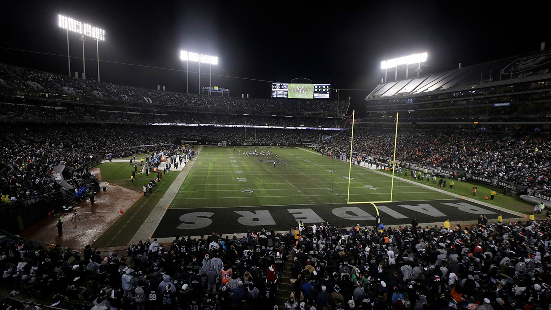 FILE - In this Dec. 24, 2018, file photo, fans watch from a general view at Oakland Alameda County Coliseum during the second half of an NFL football game between the Oakland Raiders and the Denver Broncos in Oakland, Calif. (AP Photo/Jeff Chiu, File)