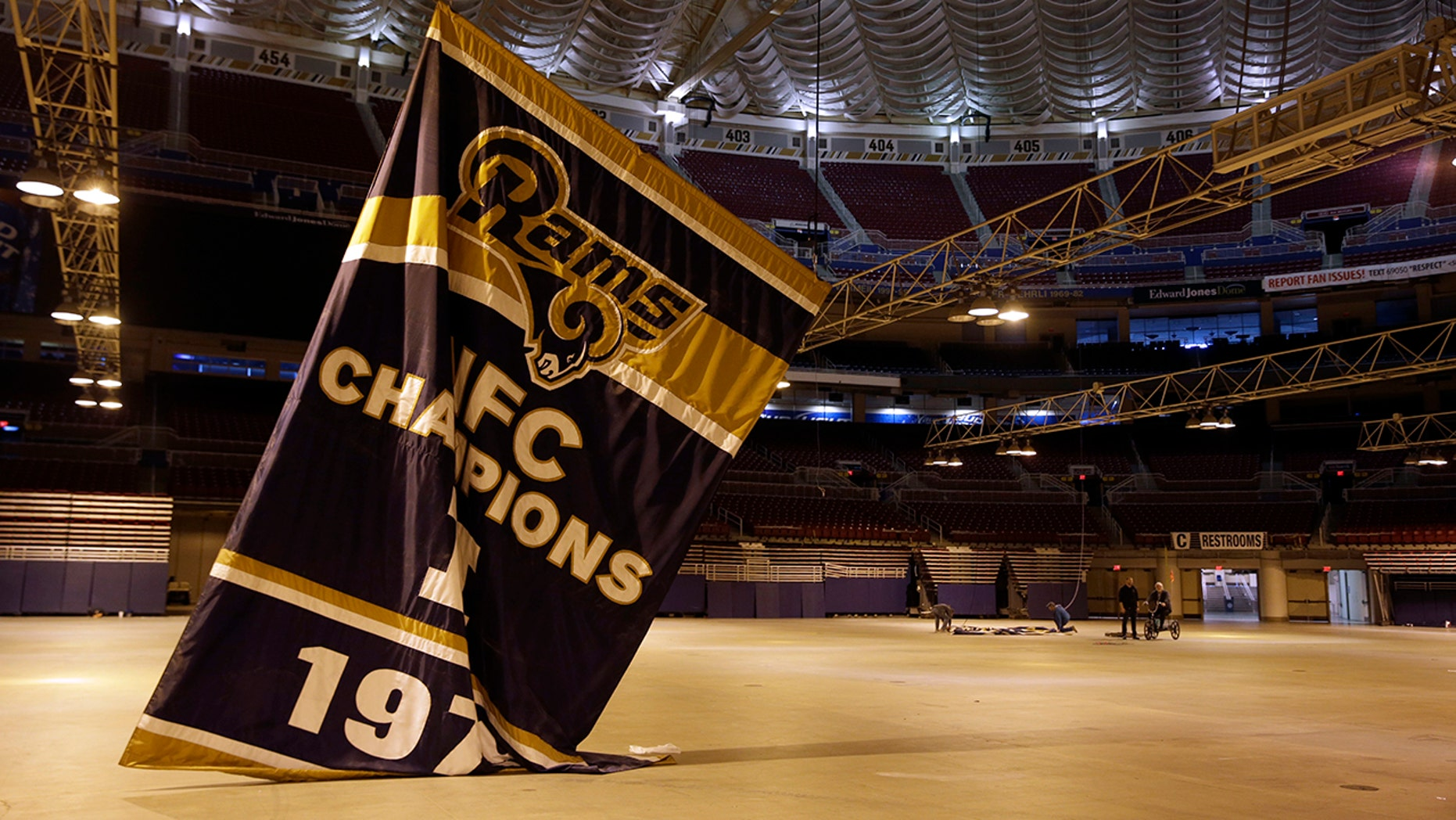 FILE - In this Jan. 14, 2016, file photo, championship banners are removed from the Edward Jones Dome, former home of the St. Louis Rams football team, in St. Louis. (AP Photo/Jeff Roberson, File)