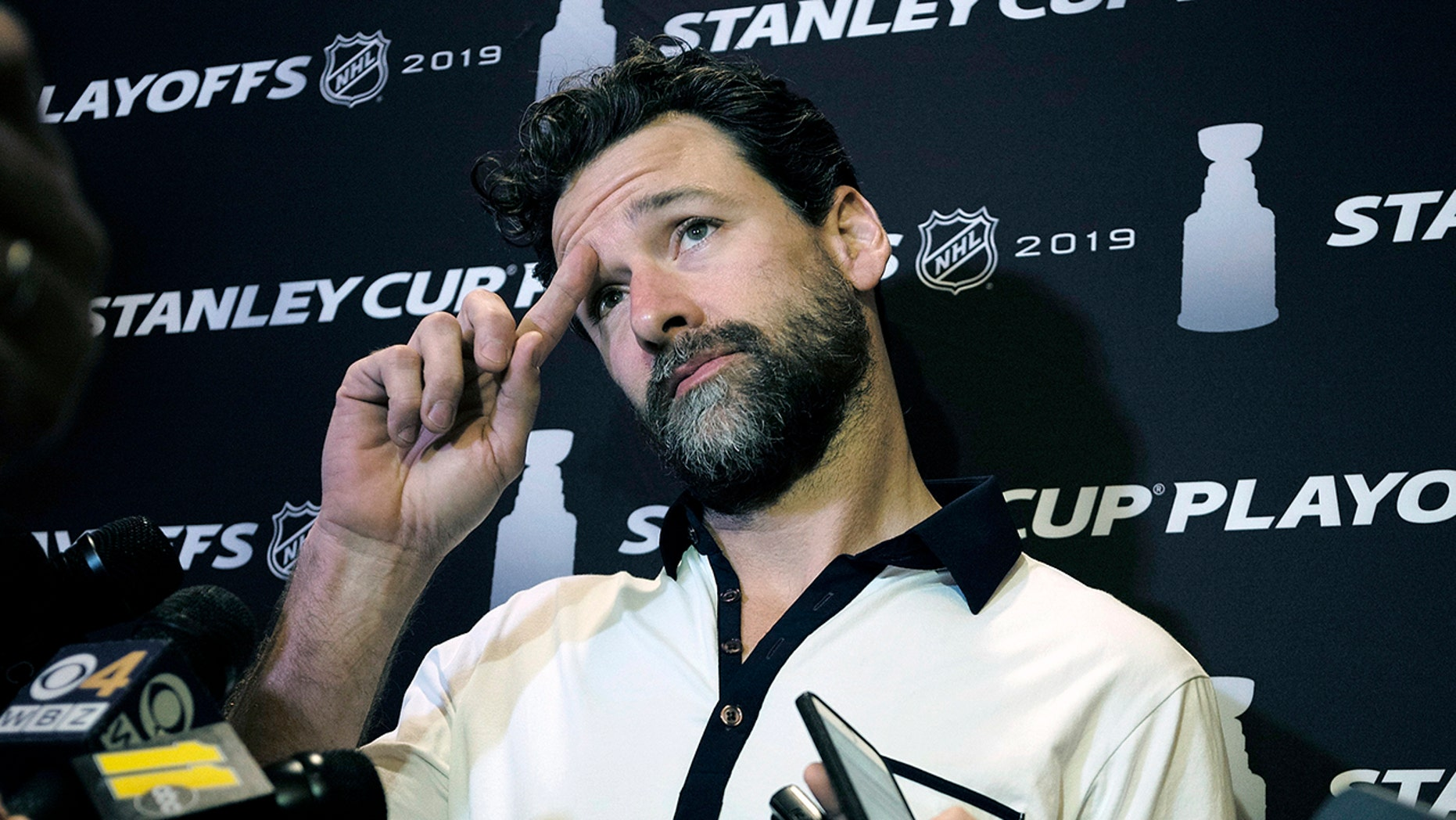 """FILE - In this Wednesday, May 8, 2019, file photo, Carolina Hurricanes' Justin Williams talks with reporters during an NHL hockey media availability in Boston. Hurricanes captain Justin Williams says he is taking a break from the NHL to start this season. The 37-year-old forward said in a statement Monday, Sept. 2, 2019, that he will """"step away"""" from the sport. (AP Photo/Steven Senne, File)"""