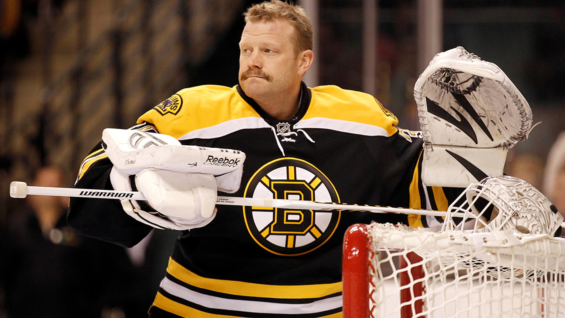 FILE - In this Feb. 4, 2012, file photo, Boston Bruins goalie Tim Thomas is shown before an NHL hockey game agains the Pittsburgh Penguins in Boston. (AP Photo/Winslow Townson, File)