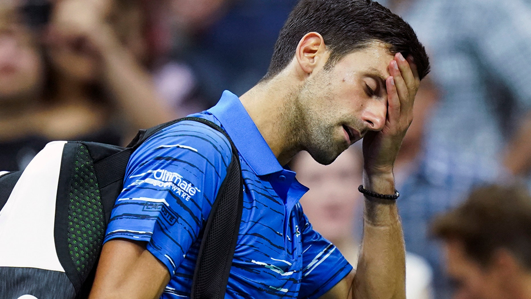 Westlake Legal Group Novak-Djokovic-THUMB Djokovic booed by crowd after retiring at US Open with bad shoulder fox-news/sports/tennis/us-open-tennis fox-news/sports/tennis fnc/sports fnc e1dc2dbf-b050-5f97-a58a-1296865725bb Associated Press article