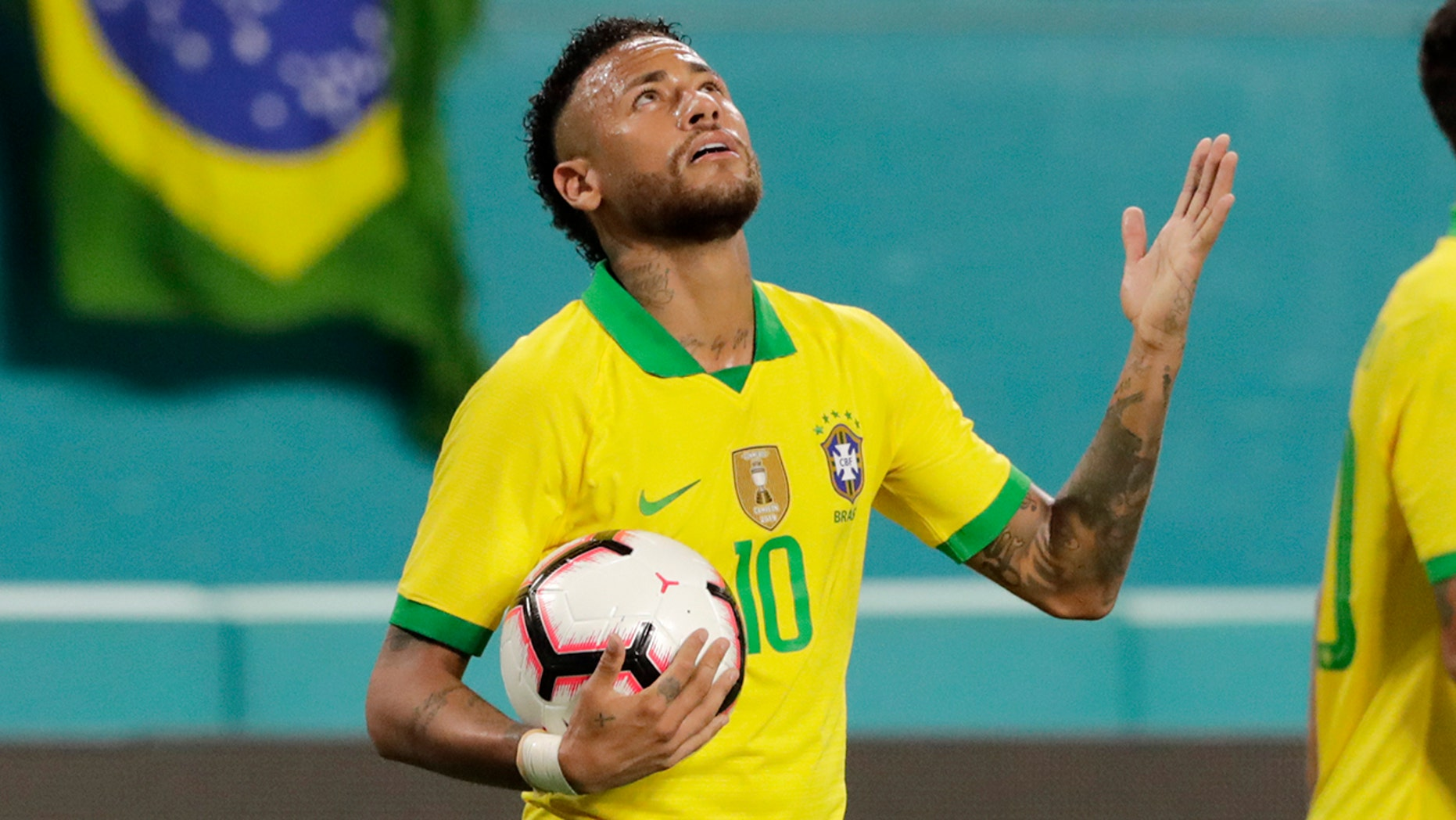 """Brazilian striker Neymar reacts after scoring in Miami Gardens, Florida in the second half of a friendly against Colombia on Friday, September 6, 201<div class=""""e3lan e3lan-in-post1""""><script async src=""""//pagead2.googlesyndication.com/pagead/js/adsbygoogle.js""""></script> <!-- Text_Display_Responsive --> <ins class=""""adsbygoogle""""      style=""""display:block""""      data-ad-client=""""ca-pub-6192903739091894""""      data-ad-slot=""""3136787391""""      data-ad-format=""""auto""""      data-full-width-responsive=""""true""""></ins> <script> (adsbygoogle = window.adsbygoogle 