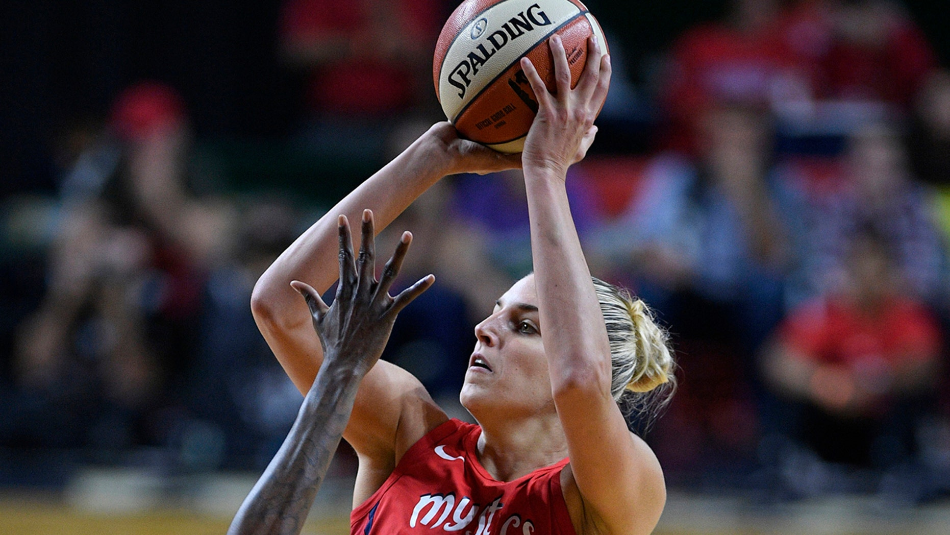 FILE - In this Sept. 12, 2018, file photo, Washington Mystics forward Elena Delle Donne (11) shoots against the Seattle Storm during the second half of Game 3 of the WNBA basketball finals, in Fairfax, Va. Delle Donne was named the Associated Press WNBA OPlayer of the Year, Wednesday, Sept. 11, 2019. (AP Photo/Nick Wass, File)