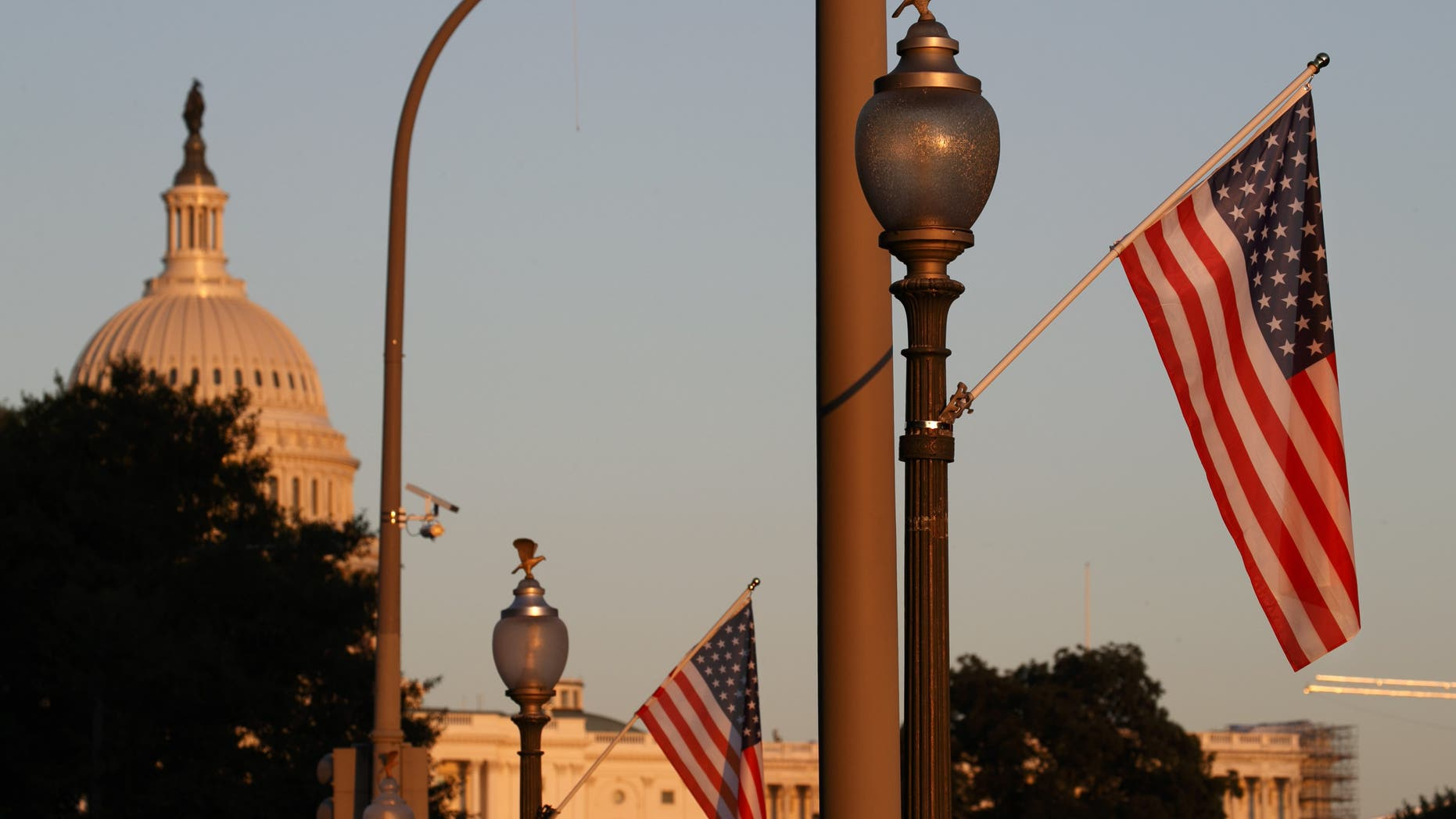 Flags fly at sunset with 51 instead of the usual 50 stars, along Pennsylvania Ave., part of a display in support of statehood for the District of Columbia, Sunday, Sept. 15, 2019, in Washington. (AP Photo/Jacquelyn Martin)
