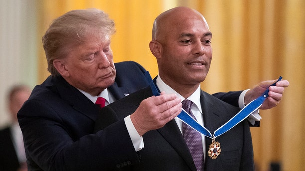 President Trump presenting the Presidential Medal of Freedom to former New York Yankees pitcher Mariano Rivera, in the East Room of the White House. (AP Photo/Manuel Balce Ceneta)
