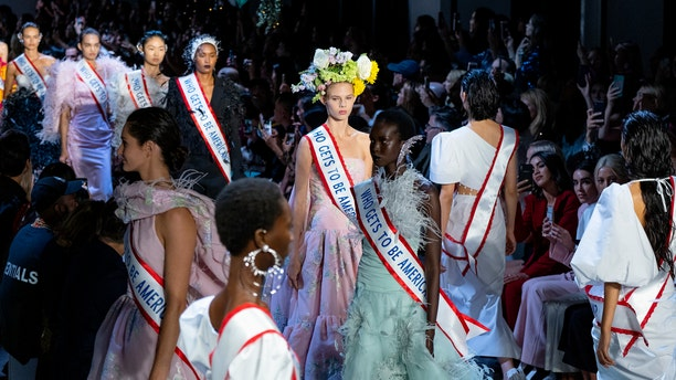 """Models sported flower crowns and also carried bunches in baskets and bouquets, as if the blooms were """"welcoming different kinds of people in this world, in this country."""""""