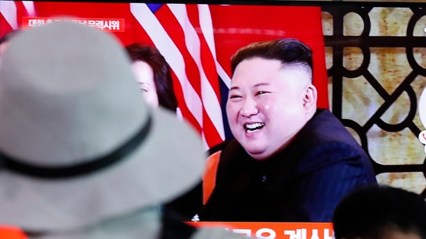 People watch a TV showing a file image of North Korean leader Kim Jong Un during a news program at the Seoul Railway Station in Seoul, South Korea, Tuesday, Sept. 10, 2019. (Associated Press)