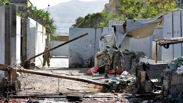 Afghan security forces work at the site of a suicide attack near the U.S. Embassy in Kabul, Afghanistan, Tuesday, Sept. 17, 2019. (AP Photo/Ebrahim Noroozi)