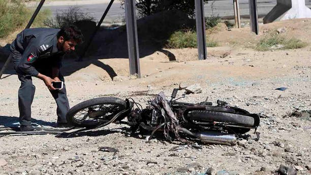 The Taliban suicide bomber on a motorcycle targeted presidential guards who were protecting President Ashraf Ghani at a campaign rally in northern Afghanistan on Tuesday, killing over 20 people and wounding over 30.