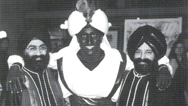 "This April 2001 photo, which appeared in a newsletter from the West Point Grey Academy, shows a costumed Justin Trudeau, his face and hands darkened by makeup, attending an ""Arabian Nights"" gala. The academy is a private school in Vancouver, B.C., where Trudeau worked as a teacher before entering politics."