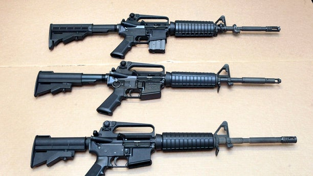 Three variations of the AR-15 rifle are displayed at the California Department of Justice in Sacramento, Calif.