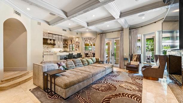 Kaley Cuoco recently slashed the asking price of the six-bedroom, nine-bathroom, Mediterranean-inspired mansion in LA's Tarzana neighborhood to $4.9 million