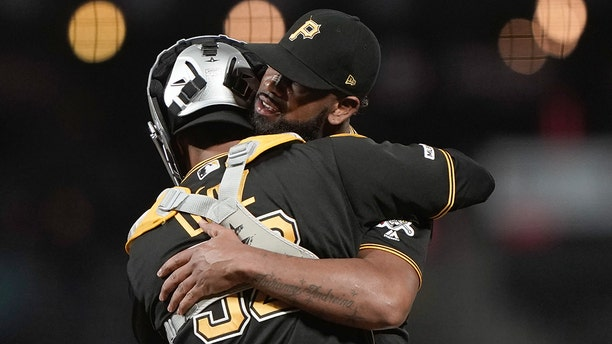 Sep 9, 2019; San Francisco, CA, USA; Pittsburgh Pirates catcher Elias Diaz (32) hugs relief pitcher Felipe Vazquez (73) after coming back from behind and defeating the San Francisco Giants at Oracle Park. Mandatory Credit: Stan Szeto-USA TODAY Sports - 13335198