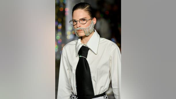 On the runway at AREA, 5 o'clock shadow got sparkly as models with crystal beards strut down the runway with nary a razor in sight.