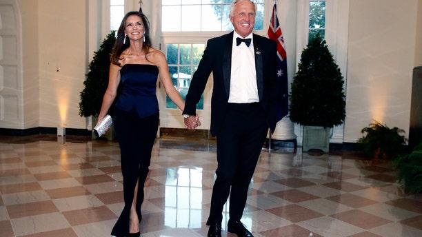 Golfer Greg Norman and wife Kirsten Kutner arrive for Friday night's state dinner. (AP Photo/Patrick Semansky)