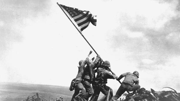 Flag raising on Iwo Jima, an iconic moment from World War II. (Photo by: Photo 12/ Universal Images Group via Getty Images)