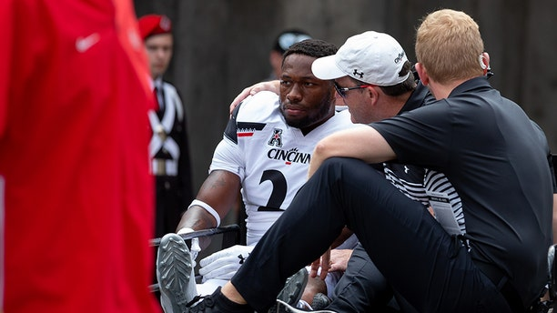 Cincinnati Bearcats safety Kyriq McDonald #26 is carted off the field after an injury during game action between the Ohio State Buckeyes and the Cincinnati Bearcats on Saturday in Columbus, Ohio.. (Photo by Adam Lacy/Icon Sportswire via Getty Images)