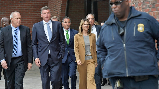 Lori Loughlin and Mossimo Giannulli appeared virtually in court Friday to plead guilty in the college admissions scandal case.