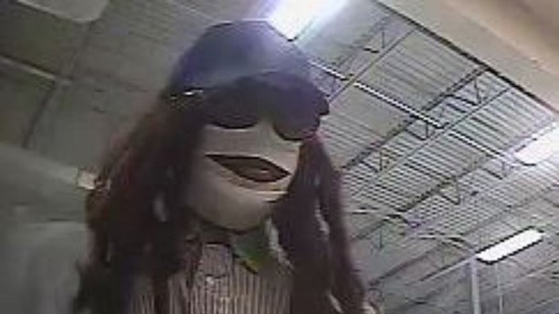 "Authorities said a bank robber dubbed the ""Mummy Marauder"" because of this white gauze covering his face robbed a Houston-area bank on Friday, Sept. 13."
