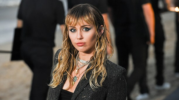Miley Cyrus at Saint Laurent men's spring-summer 2020 show on June 06, 2019 in Malibu, California.