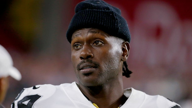Oakland Raiders wide receiver Antonio Brown watches from the sidelines during the second half of the team's NFL preseason football game against the Arizona Cardinals in Glendale, Ariz. (AP Photo/Rick Scuteri, File)