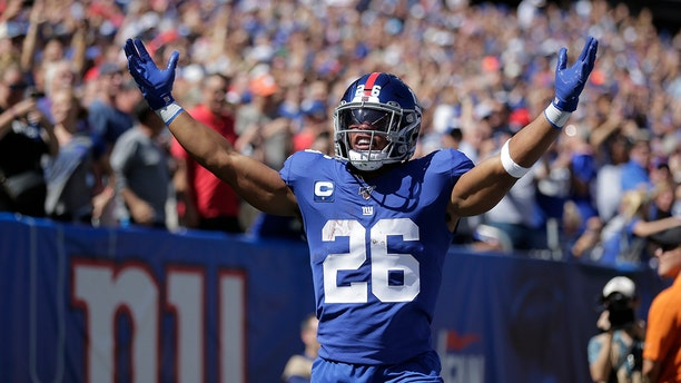 New York Giants' Saquon Barkley celebrates his touchdown during the first half of an NFL football game against the Buffalo Bills, Sunday, Sept. 15, 2019, in East Rutherford, N.J. (AP Photo/Adam Hunger)