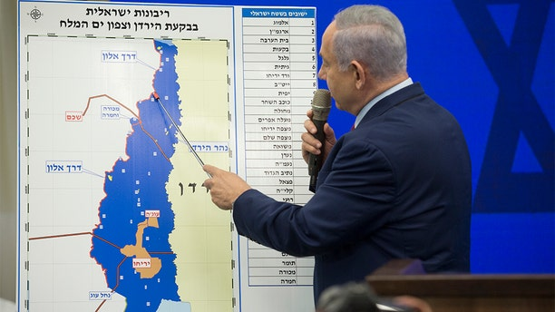 Israeli Prime Minster Benjamin Netanyahu points to a Jordan Valley map during his announcement on Tuesday in Ramat Gan, Israel. Netanyahu pledged to annex Jordan Valley in Occupied West Bank if reelected after the Sept. 17 Israeli elections. (Getty Images)