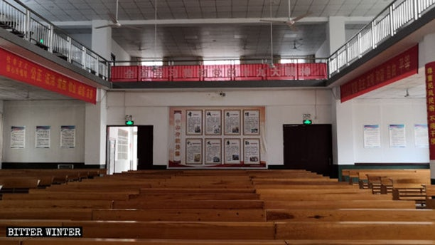 Political propaganda slogans and posters are posted throughout a Three-Self church.