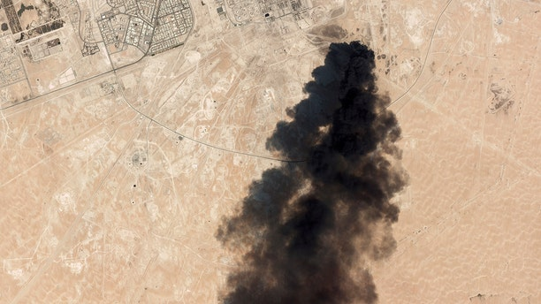 This Saturday, Sept. 14 satellite image from Planet Labs Inc. shows thick black smoke rising from Saudi Aramco's Abqaiq oil processing facility in Buqyaq, Saudi Arabia. (Planet Labs Inc via AP)