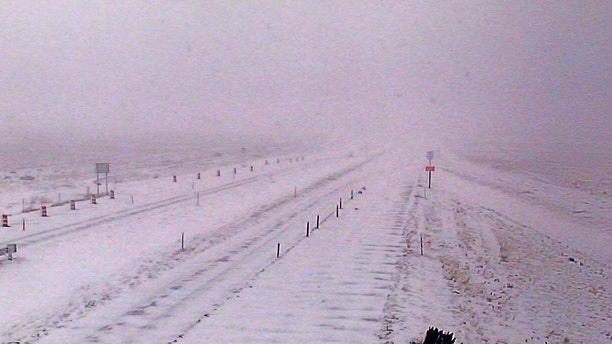 Whiteout conditions can be seen on Interstate 15 near Sieben, Mont. on Sunday as an early-season winter storm impacts the region.