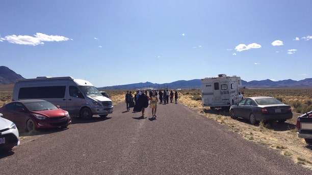 Crowds gathering outside the back gate to Area 51 in Rachel, Nev.