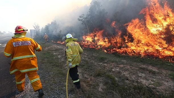 Firefighters battled bushfires in Angourie, northern New South Wales on Monday. AAP Image/Jason O'Brien/via Reuters