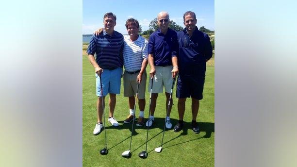 Devon Archer, far left, with former Vice President Joe Biden and his son Hunter, far right, in 2014.